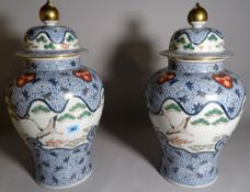 A pair of modern Chinese style porcelain vases and covers,