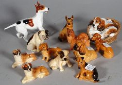 Royal Doulton; a group of twelve various dog finials, the largest 9cm high.