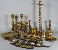 A quantity of mostly 19th century copper and brassware, including andirons, candlesticks,