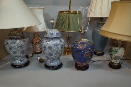 A group of seven 20th century table lamps,