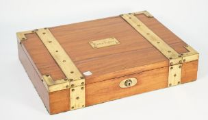 A brass bound hardwood rectangular jewellery box, with tray interior, 42cm wide x 8cm high.