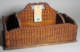 An early 20th century carved oak Tramp Art cutlery tray, 48cm wide x 24cm high.