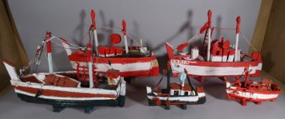 A group of eight 20th century scratch built and painted boats of various sizes,