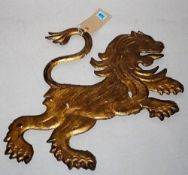 An early 20th century gold painted cast iron flatback figure of a lion, 54cm wide.