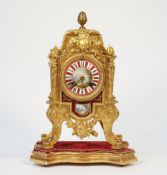 A French Louis XVI style gilt metal and porcelain mounted mantel clock, early 20th century,