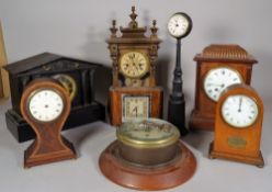 A group of eight early 20th century clocks, including; a porthole clock, 21cm wide,