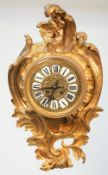 A French gilt Louis XV style gilt metal cartel clock, late 19th century,