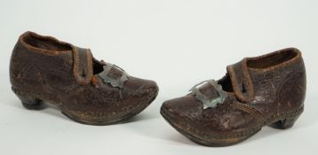 A pair of Georgian child's leather shoes, with metal buckles and wooden soles, 13cm, (2).