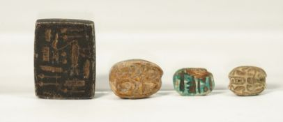 Four Egyptian carvings comprising three scarabs and a small rectangular tablet, 2.5cm, (4).