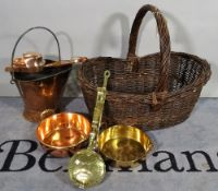 A large 20th century wicker log basket and a quantity of copper and brassware, (qty).