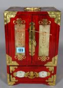 A 20th century Chinese hardwood gilt metal mounted and hardstone inlaid jewellery cabinet,