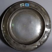 An English pewter charger, probably 17th century, touch marks to the rear, 42.5cm diameter.