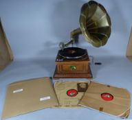 A 20th century gramophone and three records, 35cm wide x 62cm high.