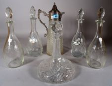 A late Victorian silver plated mounted cut glass claret jug, 36cm high, two pairs of decanters,