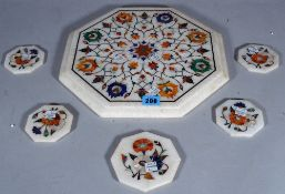A marble and specimen stone inlaid octagonal table mat and five similar coasters, (6).