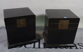 A pair of 20th century black lacquer lift top boxes, 44cm wide x 53cm high.
