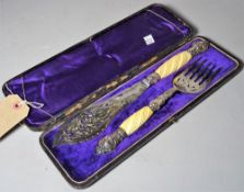 A late Victorian silver plated fish server with pierced engraved decoration, cased.