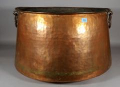 An early 20th century large Middle Eastern copper cooking pot, 62cm diameter x 40cm high.