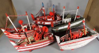 A group of nine 20th century scratch built and painted boats of various sizes,