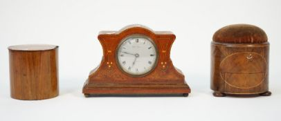 A 19th century mahogany and inlaid pin cushion of circular form with a frieze drawer and three bun