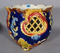 A 19th century Majolica jardiniere with pierced foliate decoration, 26cm high.