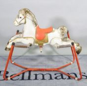 Prairie King; a mid-20th century metal painted spring rocking horse, 100cm wide x 91cm high.