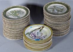 AMERICAN ATELIER; a large quantity of 20th century dinner plates with botanical decoration, (qty).