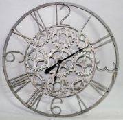 A 20th century grey painted metal wall clock, 93cm diameter.