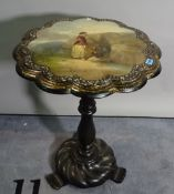 A late Victorian papier mache occasional table with painted top on turned column plinth base,