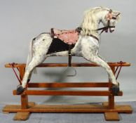 An early 20th century white and grey painted rocking horse on pine stand, 115cm wide x 96cm high.