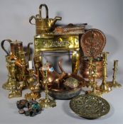 A quantity of copper and brass ware, mostly 20th century, to include jugs, kettles,
