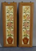 A set of ten Edwardian floral tiles within pine frames, each 27cm wide x 91cm high.