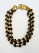 A three row necklace of graduated faceted garnet beads,