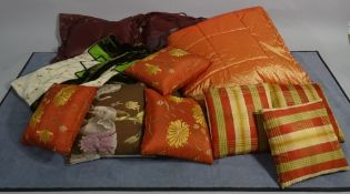 A quantity of 20th century various cushions and bed throws, (qty).