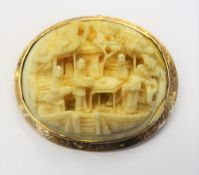A gold mounted Cantonese carved ivory oval pendant brooch, carved as various figures,