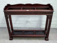 Gill & Reigate London W; a late 19th century mahogany three division stick stand,
