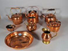 A quantity of 19th century and later copper and brass ware, including; kettles, jugs,