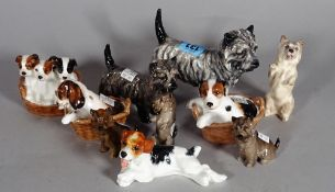 Royal Doulton; a group of ten various dog finials, the largest 11cm high.