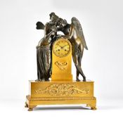 An Empire ormolu and bronze mantel clock of Cupid and Psyche The two figures leaning towards each