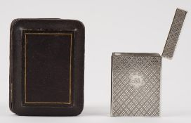 A Victorian Scottish silver rectangular visiting card case, engraved with a central cartouche,
