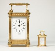 A gilt brass cased carriage clock detailed 'Vincent Weymouth' with foliate pierced frieze and