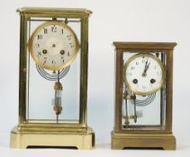 A French gilt brass cased four glass mantel clock, early 20th century, with Mercury filled pendulum,