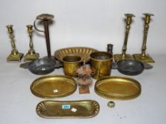 A quantity of mostly late 18th century copper and brassware including two pairs of candlesticks,