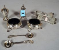 A pair of Victorian silver salts of cauldron form, with blue glass liners,