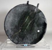 A modern circular black glass abstract sculpture on a perspex base, 46cm diameter x 44cm high, (a.f.