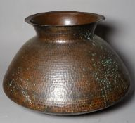 A late 19th century Arts and Crafts hammered copper vase, 33cm wide x 28cm high.