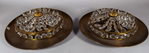 A pair of modern gilt metal circular ceiling lights of shallow dished form,