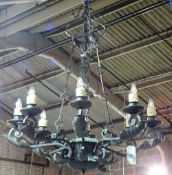 A pair of English wrought iron eight light chandeliers, late 20th century,