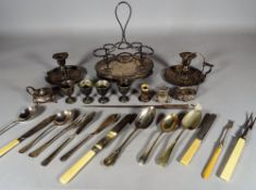 A quantity of early 20th century silver plated items including; flatware, a vinaigrette stand,