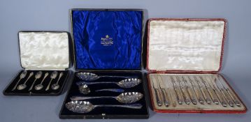 A set of six silver teaspoons, a twelve piece fruit knife and fork set (one knife lacking), cased,